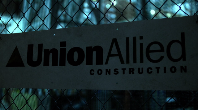File:Into the Ring Union Allied Construction sign.png