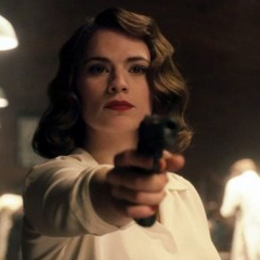 Peggy Carter testing Steve's new shield.