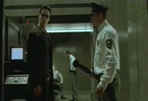 Neo and security guard