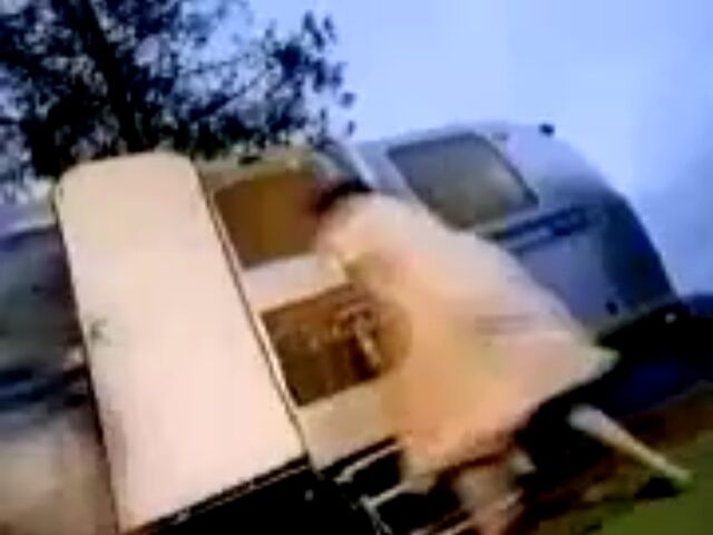 File:Boy's mom opens door of trailer.jpeg