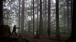 Thea aims a gun at Slade Wilson