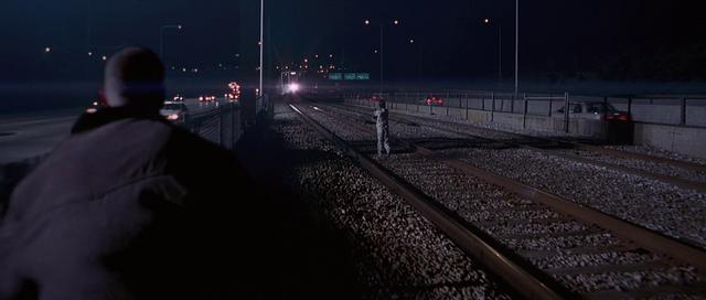 File:Simon wanders onto the tracks.png