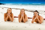 Lyla, Sirena And Nixie Lying On Sand