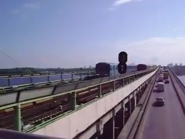 File:Kiev Metro 2trains passing elevated structure with highway.jpg