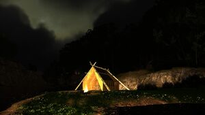 Campfire by a lonely hut