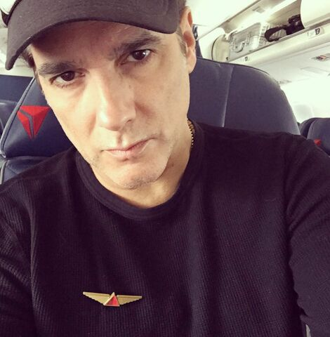 File:Yul Vazquez on plane.jpg