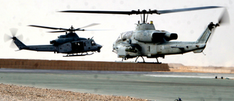 UH-1Y and an AH-1W take off