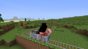 180px-Player riding pig riding minecart pushed by powered minecart