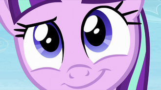 An extreme close-up of Starlight smiling S5E26