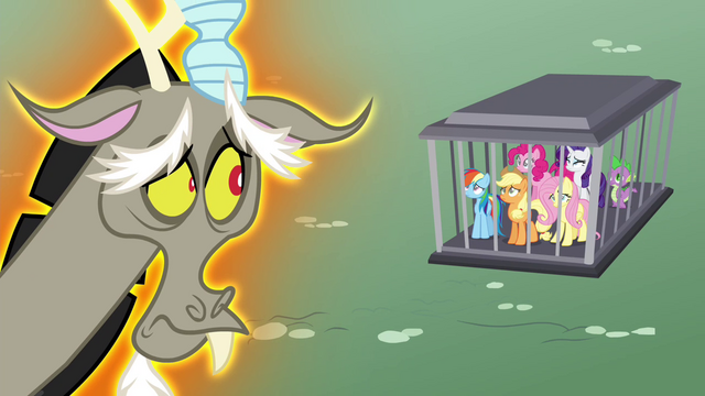 File:Discord looking at his pony friends S4E26.png