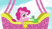 Pinkie Pie waves her hoof in Gummy's face S7E11