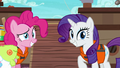 Pinkie and Rarity grinning at Applejack S6E22.png