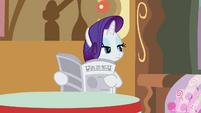 Rarity looking through the newspaper S2E23