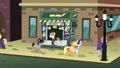 Rarity and Applejack leave newspaper stand in defeat S5E16.png