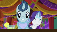 Rarity tying bib around polo pony's neck S6E12