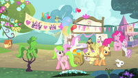 Pinkie Pie hopping while Applejack is pulling a wagon S4E14