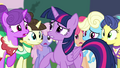 Twilight surrounded by Canterlot ponies S4E01.png