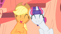 Applejack and Rarity laughing together S1E08