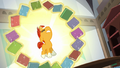 Books levitate in a circle around Sunburst S6E1.png