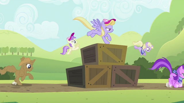 File:Ponies getting up and over the crates S2E05.png