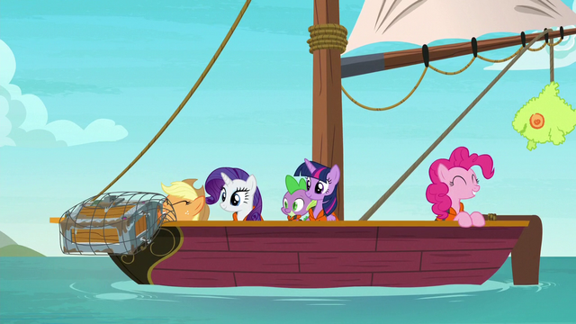 File:Applejack fishes a treasure chest out of the sea S6E22.png