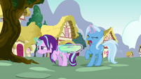 Starlight and Trixie fight over the saddlebag S7E2