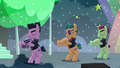 Backup dancers on right dancing by moving their arms S5E24.png