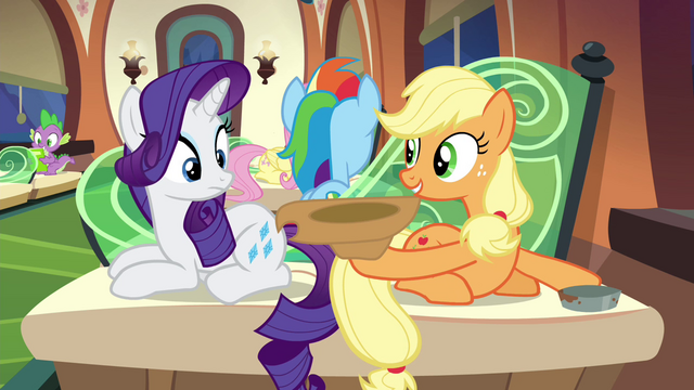 File:Applejack holding out her hat S4E22.png