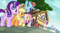 Starlight and main ponies look over at Pinkie S6E21
