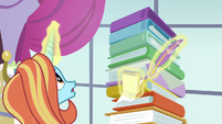 Sassy Saddles looking at her stack of binders S7E6
