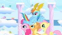 Pinkie Pie, Applejack, and Fluttershy carry victorious Rainbow Dash on their backs S1E16