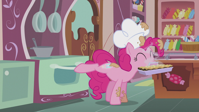 File:Pinkie closes oven while her cutie mark glows S5E8.png