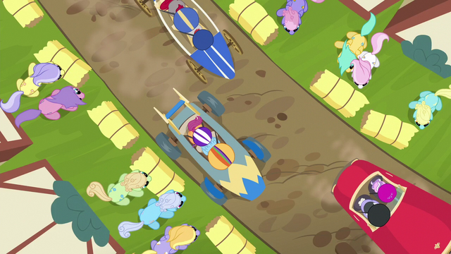 File:Overhead view of carts racing around a bend S6E14.png