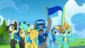 A pony holds up the blue team flag S3E07.png