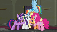 Rarity's friends group hug around her S6E9