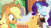 Rarity tucks blanket into Applejack's cradle S6E1