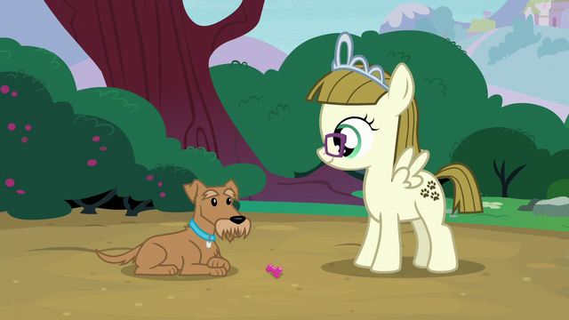File:Ripley looking at his squeak toy S7E6.png