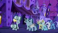 Rarity leading a crowd to The Tasty Treat S6E12