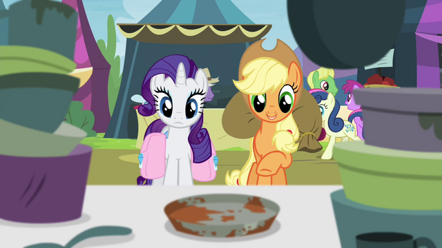 File:Applejack pointing toward vintage pie tin S4E22.png