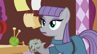 Maud holding a dishtowel S4E18