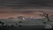 Twilight, Spike, and Starlight on the barren landscape S5E26