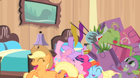 Rarity's friends laughing while Spike carries Rarity's bags S4E08