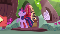 Twilight smiling with her hoof raised S3E13