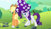 Rarity touching one of the rocks S4E18.png