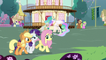 AJ, Rarity, and Fluttershy walk through Ponyville S7E1.png