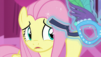 Fluttershy pushes the mask away S5E21