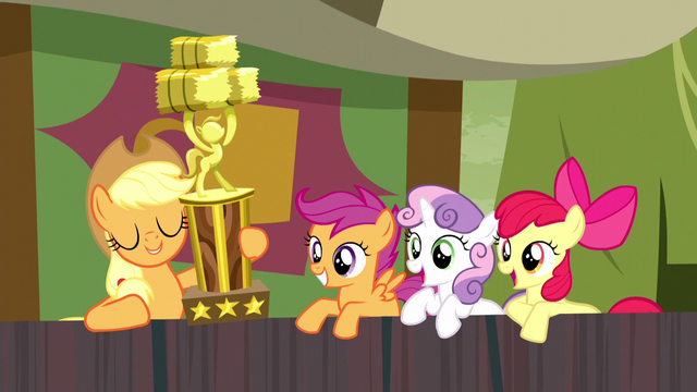 File:Applejack appears with hay stacking trophy S5E6.png