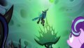 Queen Chrysalis flies down from the ceiling S6E26.png