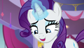 Rarity affectionately notices the photograph S7E6.png