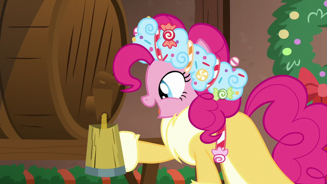 File:Spirit of HW Presents pouring cup of cider S6E8.png